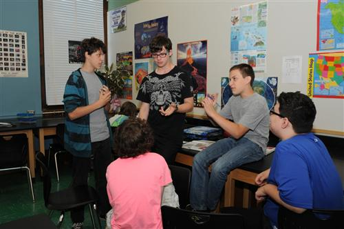 middle school students discussing social studies