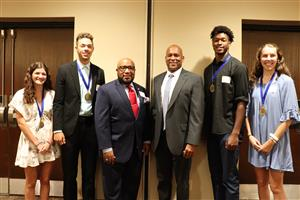 Student champions pose with Dr. Anthony Lewis and keynote speaker Darryl Monroe