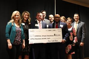 Truity Credit Union presented a $50,000 check to the Foundaton