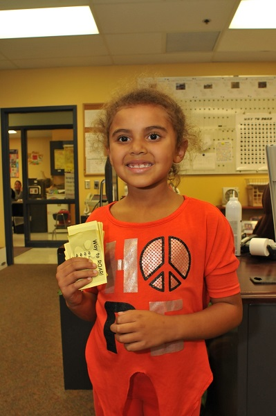 elementary student collects Positive Action tickets
