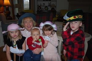 Gail Vick and four of her grandchildren enjoy her annual Grandma Christmas Tea Party.