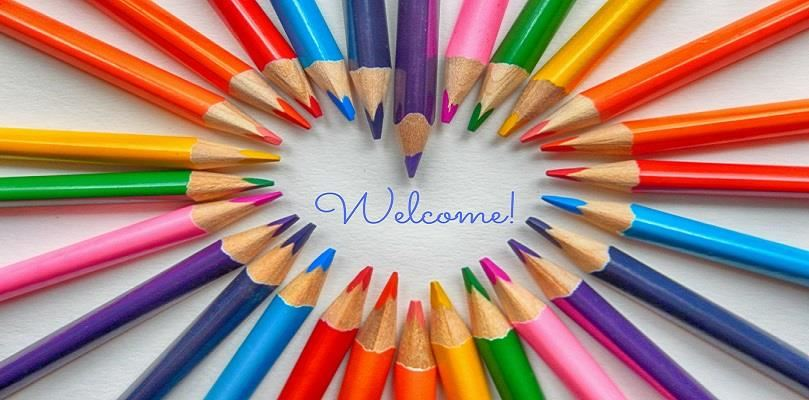 colored pencils in the shape of a heart with Welcome! in the middle