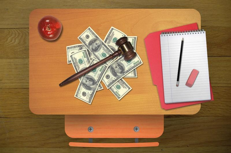 desk with apple, money, gavel, paper, pencil and eraser
